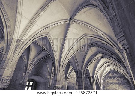 HUNEDOARA, ROMANIA - AUGUST 13, 2015: gothic vaults Knight's Hall of Corvin Castle in Hunedoara, Romania