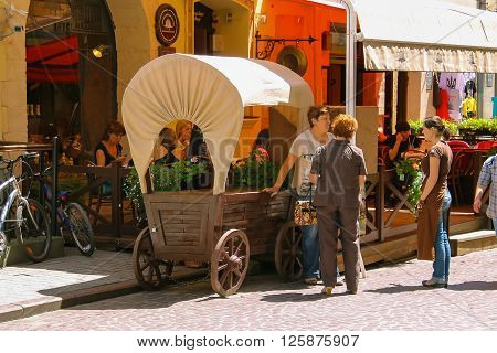 Lviv Ukraine - July 5 2014: People resting in outdoor cafe in historic city centre