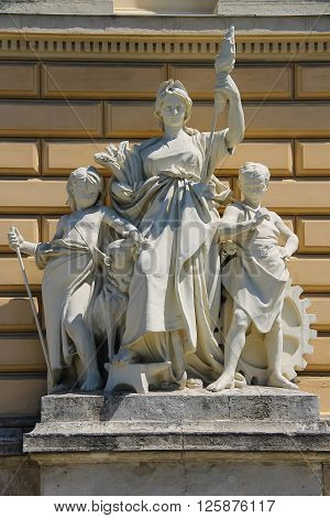 Allegorical sculpture composition Work on facade of Ivan Franko National University main building. Lviv Ukraine