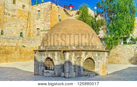 The cupola in the middle of the roof section of the Church of the Holy Sepulchre admits light to St Helena's crypt located below this area belongs to the Ethiopian Monastery Jerusalem Israel.