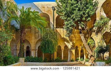 JERUSALEM ISRAEL - FEBRUARY 16 2016: The scenic green garden in courtyard of Lutheran Kirche of the Redeemer on February 16 in Jerusalem.