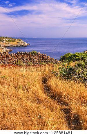 SUMMER SEASCAPE. Salento coast:Bay Uluzzo (Lecce).ITALY (Apulia).Bay Uluzzo .In the background the city of Gallipoli. Bay Uluzzo is a small natural gulf located within the protected area known as Porto Selvaggio.