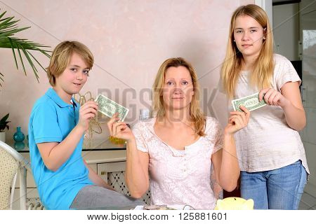 blond mother giving her children pocket money