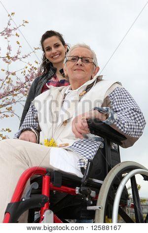 Young woman helping senior woman