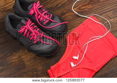 Sport items on the dark wooden background