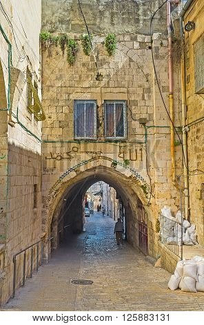 JERUSALEM ISRAEL - FEBRUARY 16 2016: The narrow streets of the old city are full of tiny houses passages stairs and hiden yards on February 16 in Jerusalem.