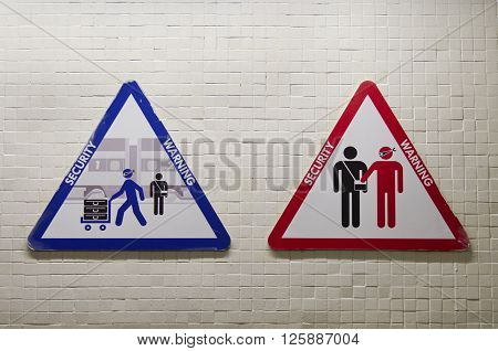 Triangular Sign To Warn About The Risk Of Being Robbed