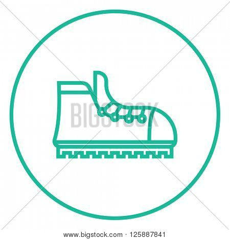 Hiking boot with crampons line icon.