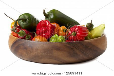 bowl of assorted peppers isolated on white background