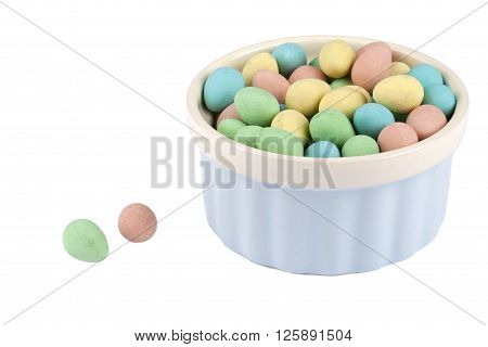 bowl of colorful easter eggs isolated on white background