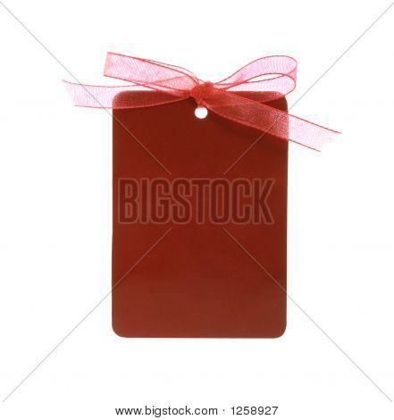 Red Gift Tag Tied With Ribbon (With Clipping Path)