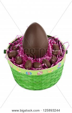 chocolate eggs and green basket isolated on a white background