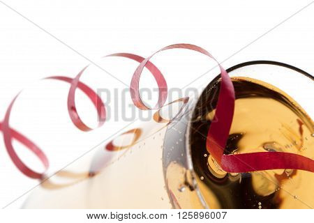 Cropped Image Of Streamer And Champagne Flute