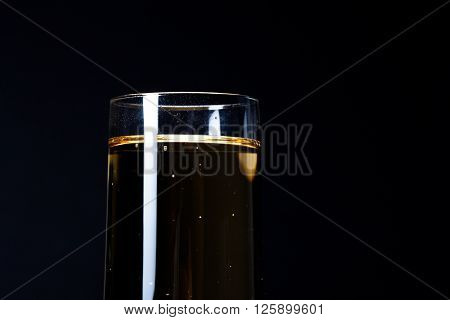 glass of champagne isolated against black background