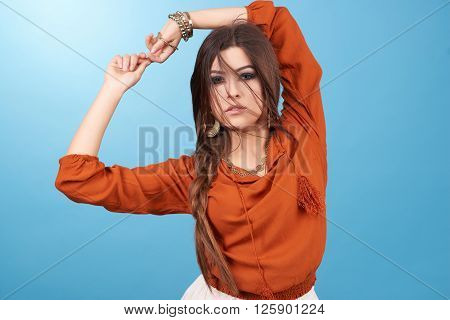 Portrait of beautiful glamor hipster young hippie woman in studio. Boho style