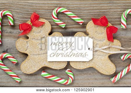 Image Of A Female Gingerbread Candies With A Merry Christmas Tag And Candy Canes