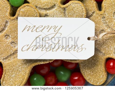 Merry Christmas Tag With Gingerbread Cookies And Candies