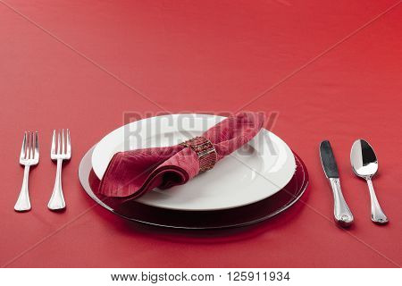 Table Setting With Utensils Plate And Red Cloth