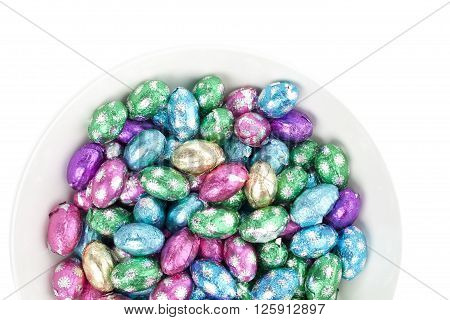 top view of easter egg chocolates isolated on white background