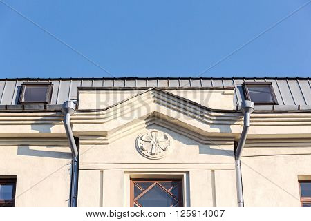 Old House Facade With Downspout
