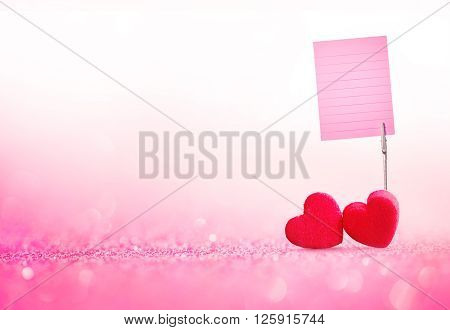 The red Heart shapes and card holder the memo paper on abstract light glitter background in love concept for valentines day with sweet and romantic moment