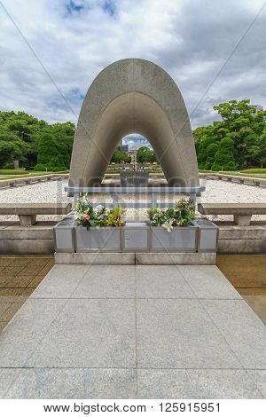 Hiroshima, Japan - July 10, 2014: In the center of Hiroshima Peace Memorial Park the Memorial Cenotaph holds the names of all of the people killed by the Atomic Bombing of Hiroshima (