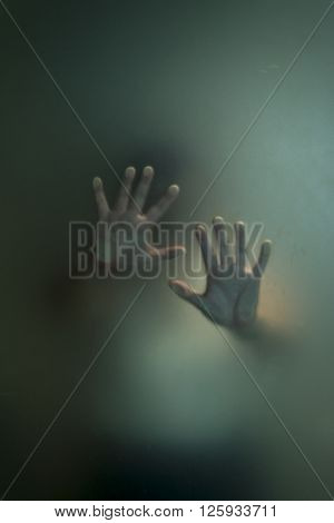 Halloween series : Silhouette of hand through frosted glass