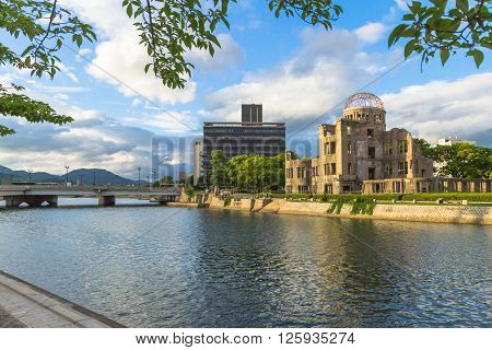 Hiroshima, Japan - July 10, 2014: Hiroshima city and the Atomic Bomb Dome (Hiroshima Peace Memorial) that was destroyed by the Atomic Bomb. Left: Aioi bridge (rebuilt) and Aioi river.