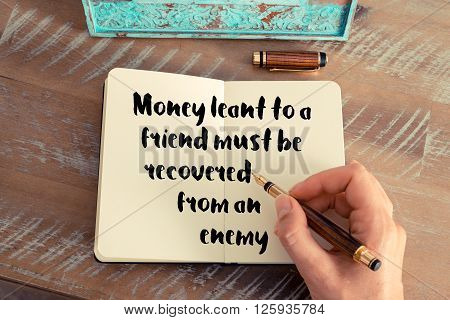 Handwritten quote Money leant to a friend must be recovered from an enemy, as inspirational concept image