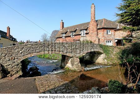 A picture-postcard English Village in northern Somerset in Springtime showing the fordbridge River Aller and cottages.