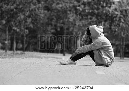Nervous and Lonely Girl Sitting on the Road
