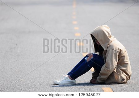 Sad and Heartbroken Girl Sitting on the Road