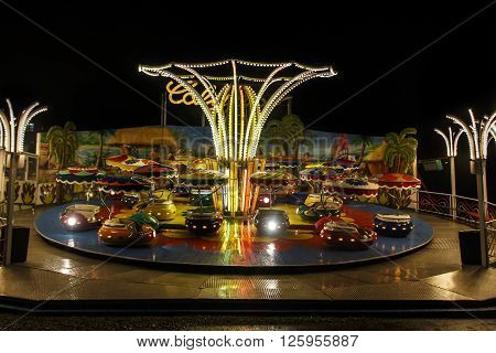 MUNICH, GERMANY - SEPTEMBER 18, 2015: Nightshot of the Calypso fun ride on Theresienwiese