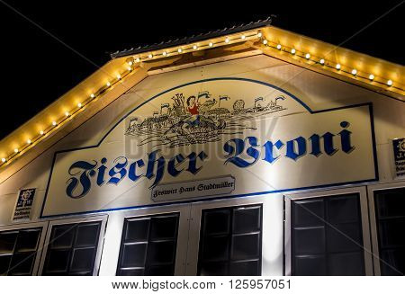 MUNICH, GERMANY - SEPTEMBER 18, 2015: Nightshot of the Fischer Vroni tent on the Theresienwiese during Oktoberfest