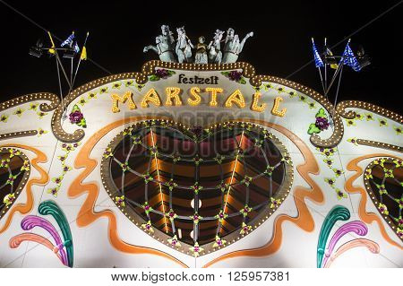 MUNICH, GERMANY - SEPTEMBER 18, 2015: Nightshot of the Marstall tent on the Theresienwiese in Munich during Oktoberfest