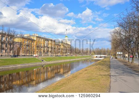 View of the Komsomol channel and Kolpino town at spring sunny day on the outskirts of St. Petersburg Russia.