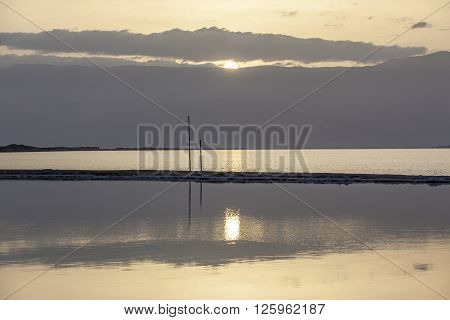 Sunrise at Dead Sea with headland and mountains background
