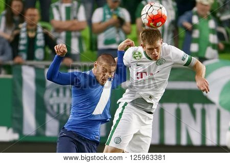 BUDAPEST HUNGARY - APRIL 16 2016: Michal Nalepa of Ferencvaros (r) battles for the ball in the air with Darko Nikac of MTK Budapest during Ferencvaros - MTK Budapest OTP Bank League football match at Groupama Arena.