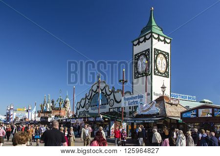 MUNICH, GERMANY - OCTOBER 02, 2015: Main street at Oktoberfest with the Augustiner tent on Theresienwiese and its famous tower