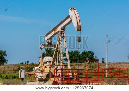 Oil Well Pumpjack in Texas or Oklahoma. A Wealth-Making Machine for the Oil Industry.