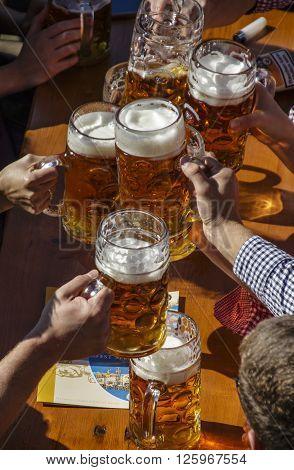 MUNICH, GERMANY - OCTOBER 02, 2015: The beer garden of the Braeurosl beer tent with people celebrating Oktoberfest