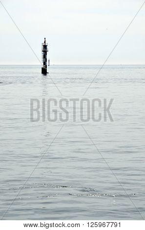 Signaling buoy in the sea at dusk