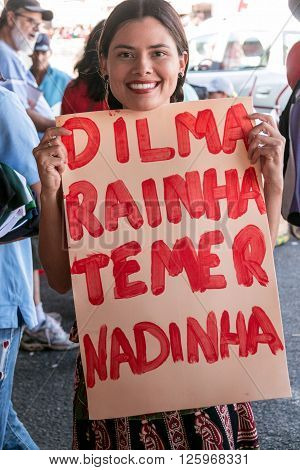 Brasilia, Brazil April 16th 2016 A young woman shows her support at a rally for President Dilma Rousseff