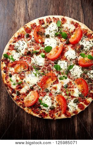 Pizza with tomatoes and mozzarella cheese