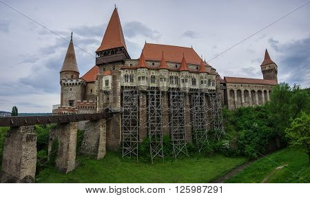 Beautiful panorama of the Corvin castle with wooden bridge and bench Hunedoara, Transylvania, Romania, Europe