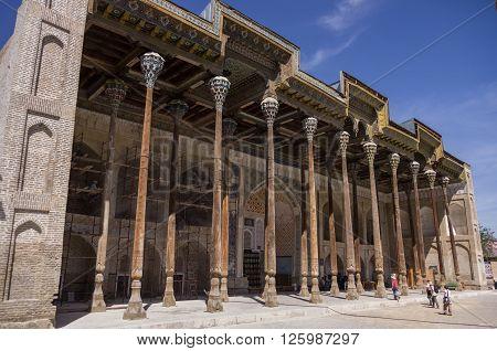 Bukhara, Uzbekistan - 1 May, 2015: Complex Bolo-hauz - consisting of a mosque a minaret and a pool Bukhara Uzbekistan