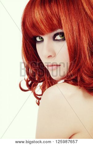 Vintage style portrait of young beautiful red-haired girl with smoky eyes make-up, copy space