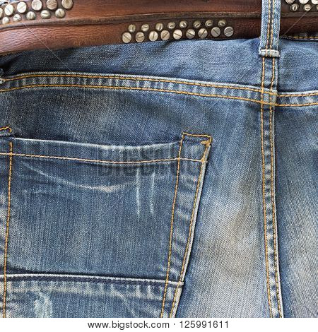 blue jeans with brown leather belt, clothing industry