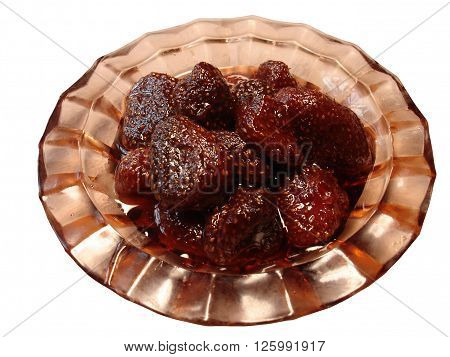Strawberry jam in small jam dish on a white background.