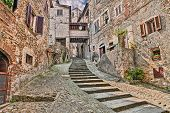 picturesque old narrow alley with staircase in the medieval village Anghiari, province of Arezzo, Tuscany, Italy poster